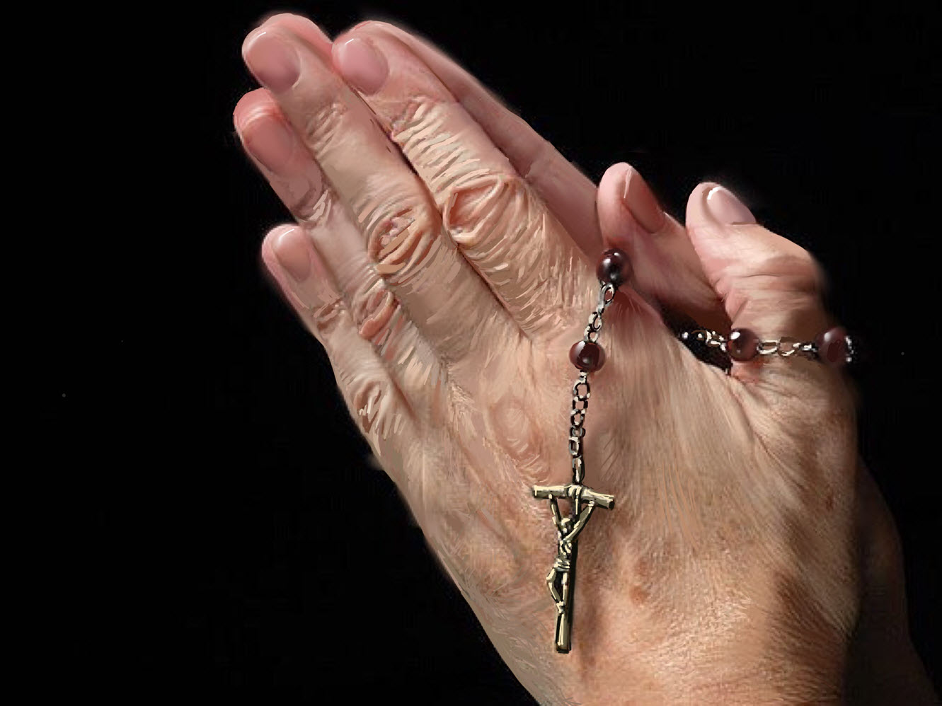 Elderly Hands Praying with Rosary Beads